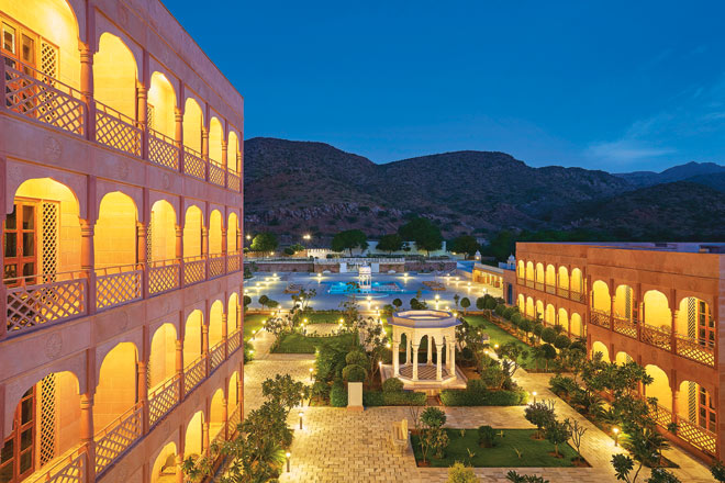 The Gateway Hotel Pushkar glimmers beautifully against a mountain backdrop