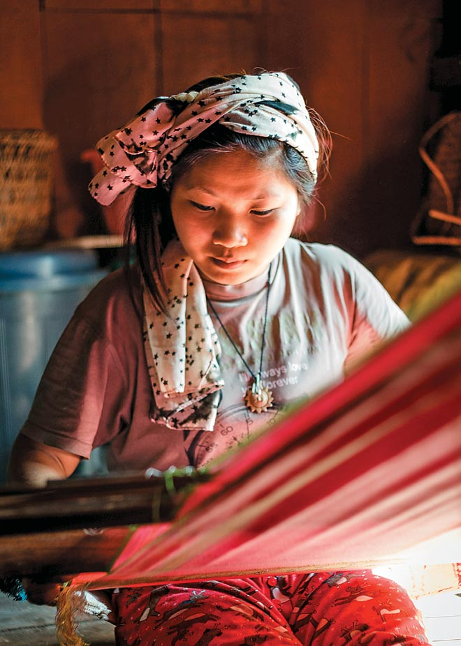 Adi women weave their own sarongs and scarves