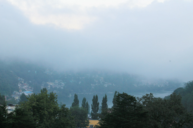 Naini lake, on a foggy day, as seen from The Manu Maharani Hotel