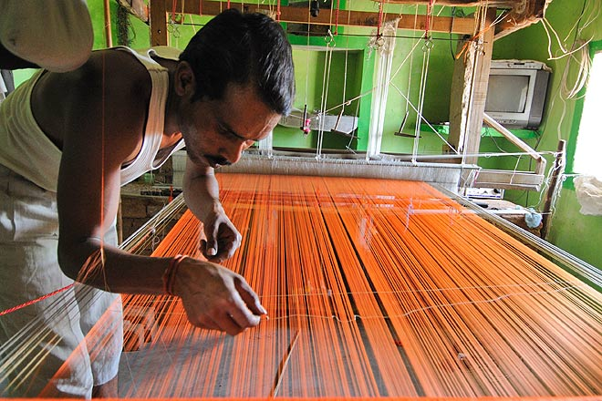 A weaver at his loom in Pranpur