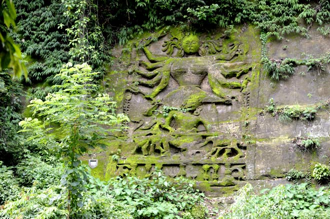 A rock-cut mural of Durga, also called Sakragma by the local Jamatiya tribe in the middle of a forest on the Gomati river at Chabimura