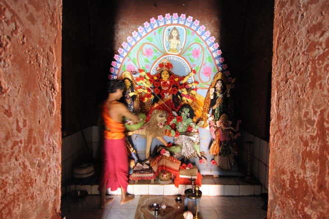 A priest worships a newly-made Durga statue in a medieval Udaipur temple