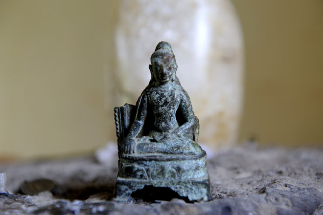 An ancient bronze sculpture of the Buddha excavated at Pilak