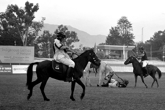 A rider falls off his pony while playing polo at the competition