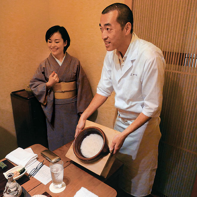 Chef Hideki Ishikawa displays the freshly harvested rice from his native Niigata Prefecture
