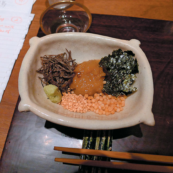 Accompaniments for the rice, including dashi, pickled vegetables and wasabi